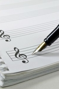 Image of pen writing music score